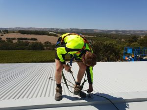 man attaching the roof anchor